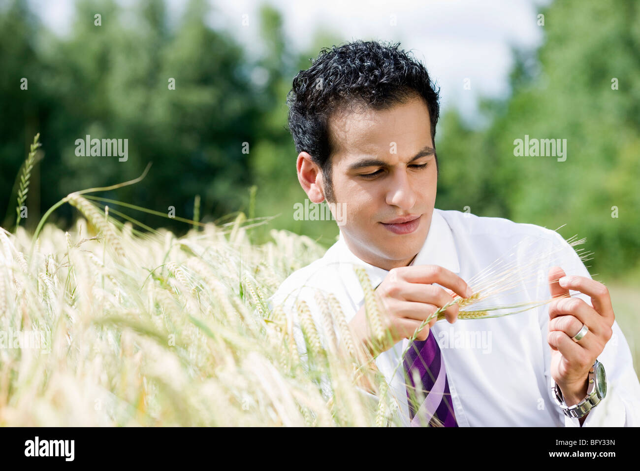 businessman feeling spike - Stock Image