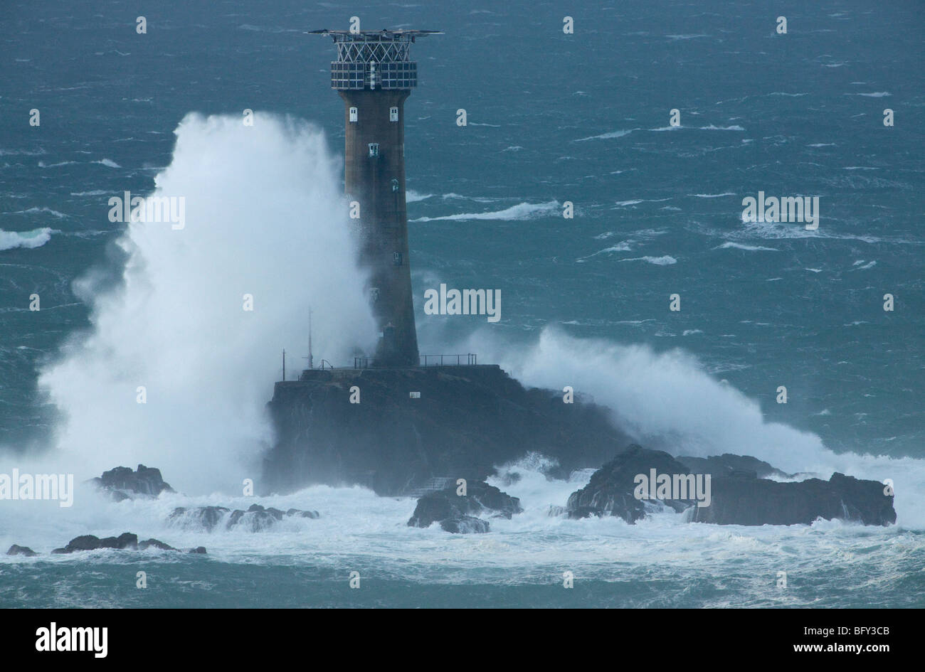 Longships Lighthouse in stormy seas. Stock Photo