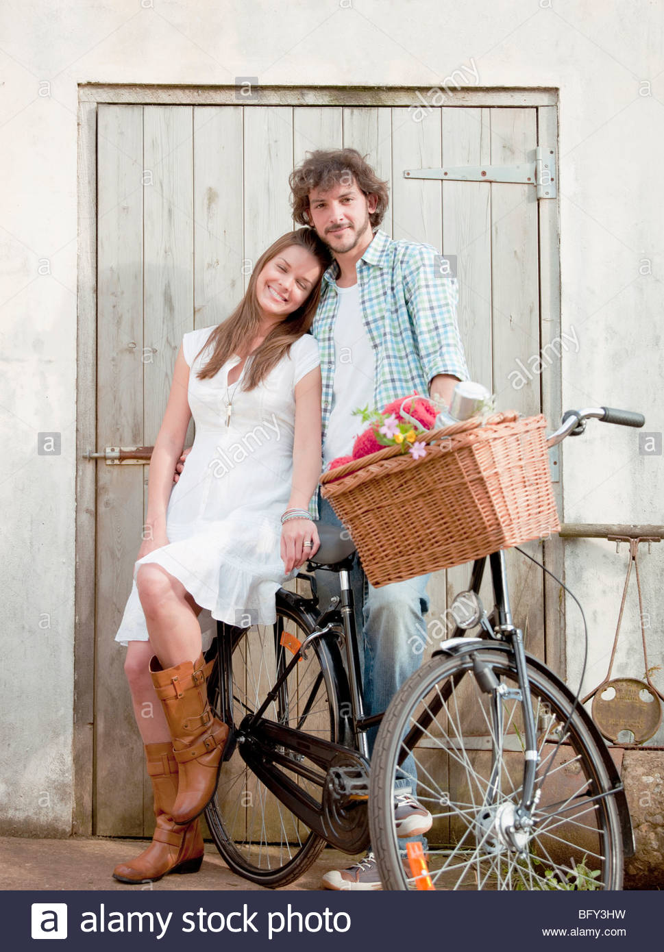 Man and woman together with bike - Stock Image