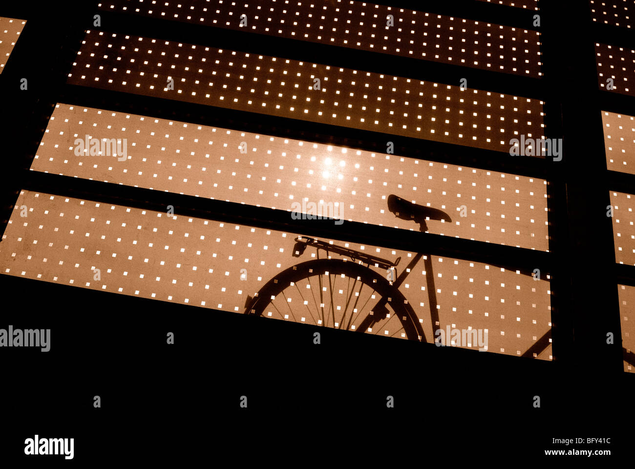 BICYCLE SILHOUETTED - Stock Image