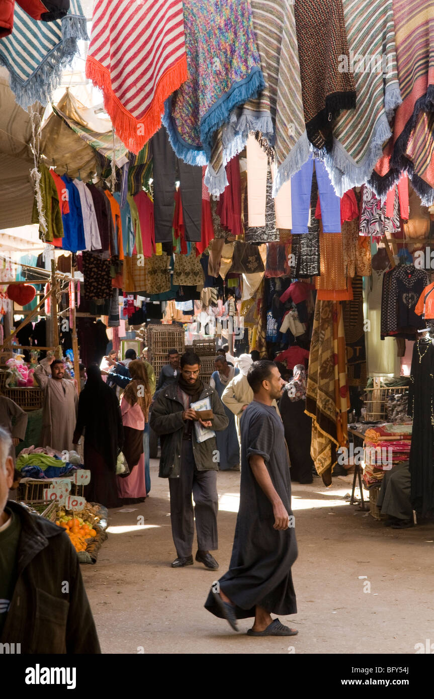 Colourful clothes bazaar souk market in Luxor Egypt. - Stock Image