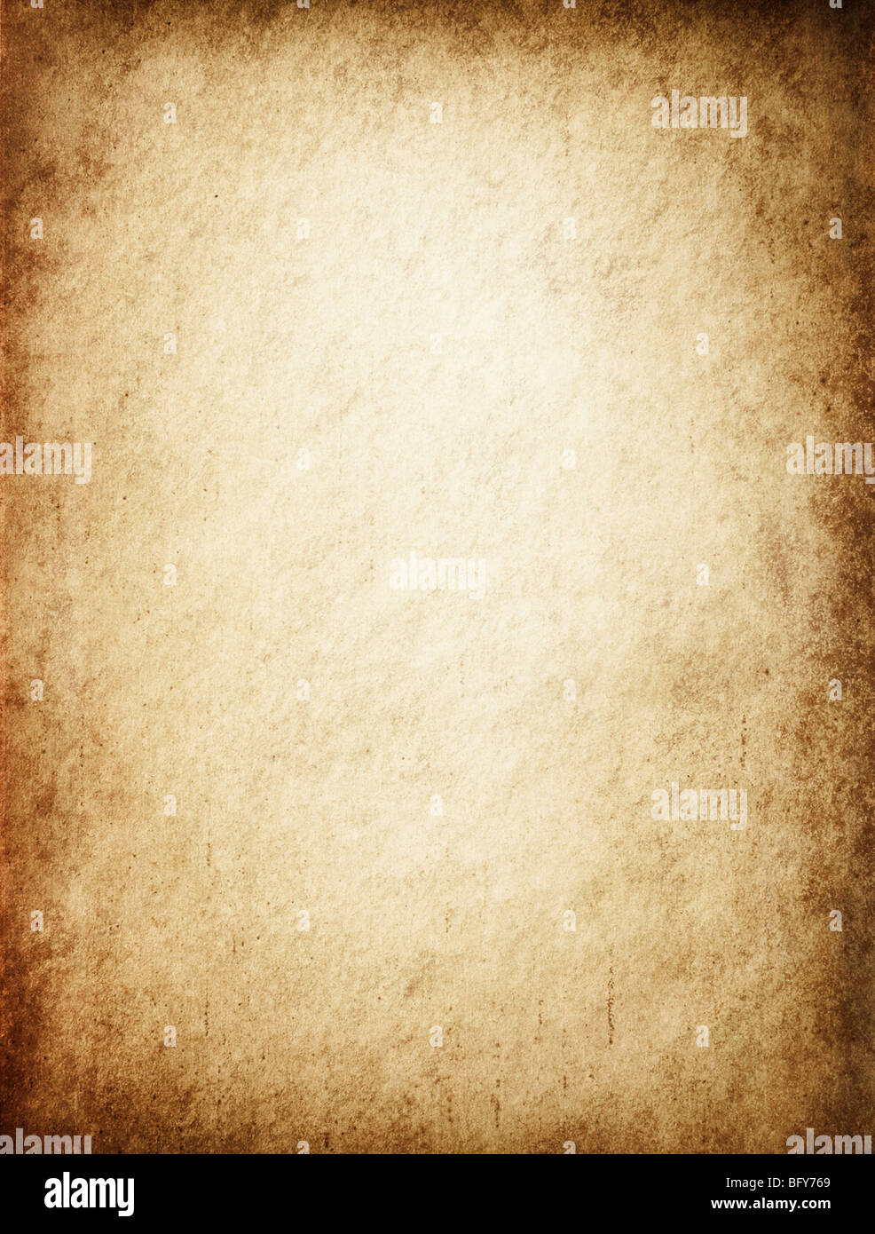 Antique yellowish parchment paper grungy background texture - Stock Image