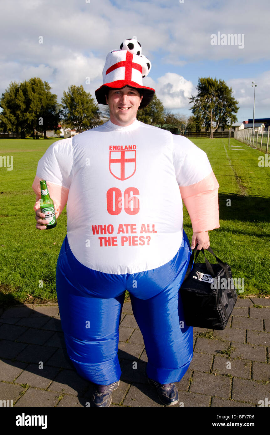 English football supporter with inflatable costume - Stock Image