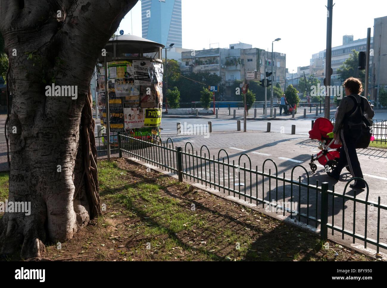 Rothschild boulevard pedestrian promenade in Tel Aviv. mother with pushchair enjoying a morning stroll on saturday - Stock Image
