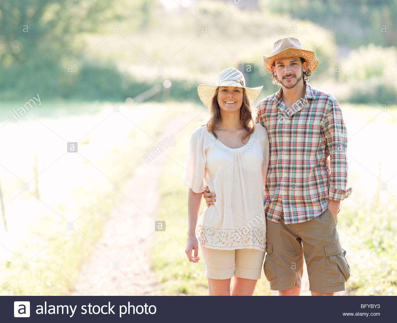 Man and woman walking down lane - Stock Image