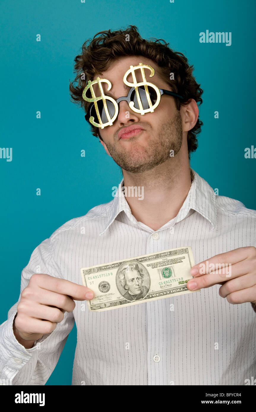 5eb6ac50ea55 Businessman wearing dollar sign sunglasses and holding money Stock ...