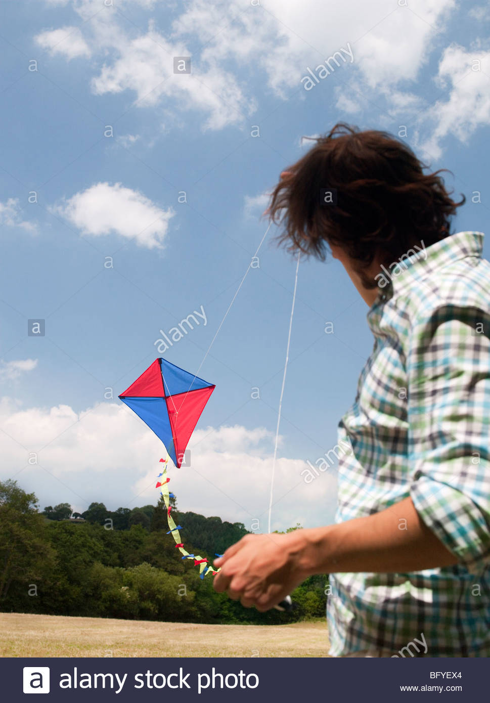 man flying kite - Stock Image