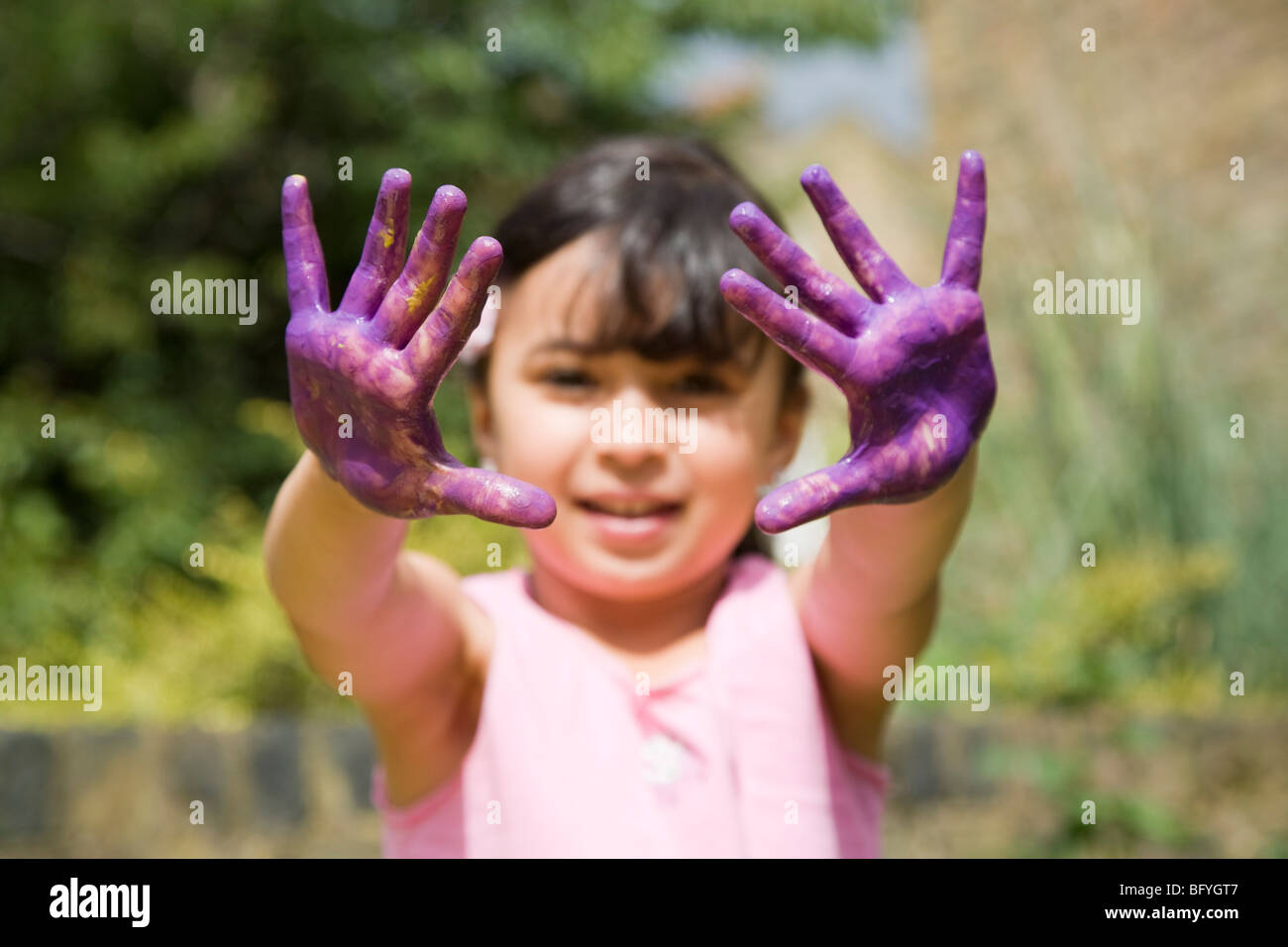 Girl with painted hands - Stock Image
