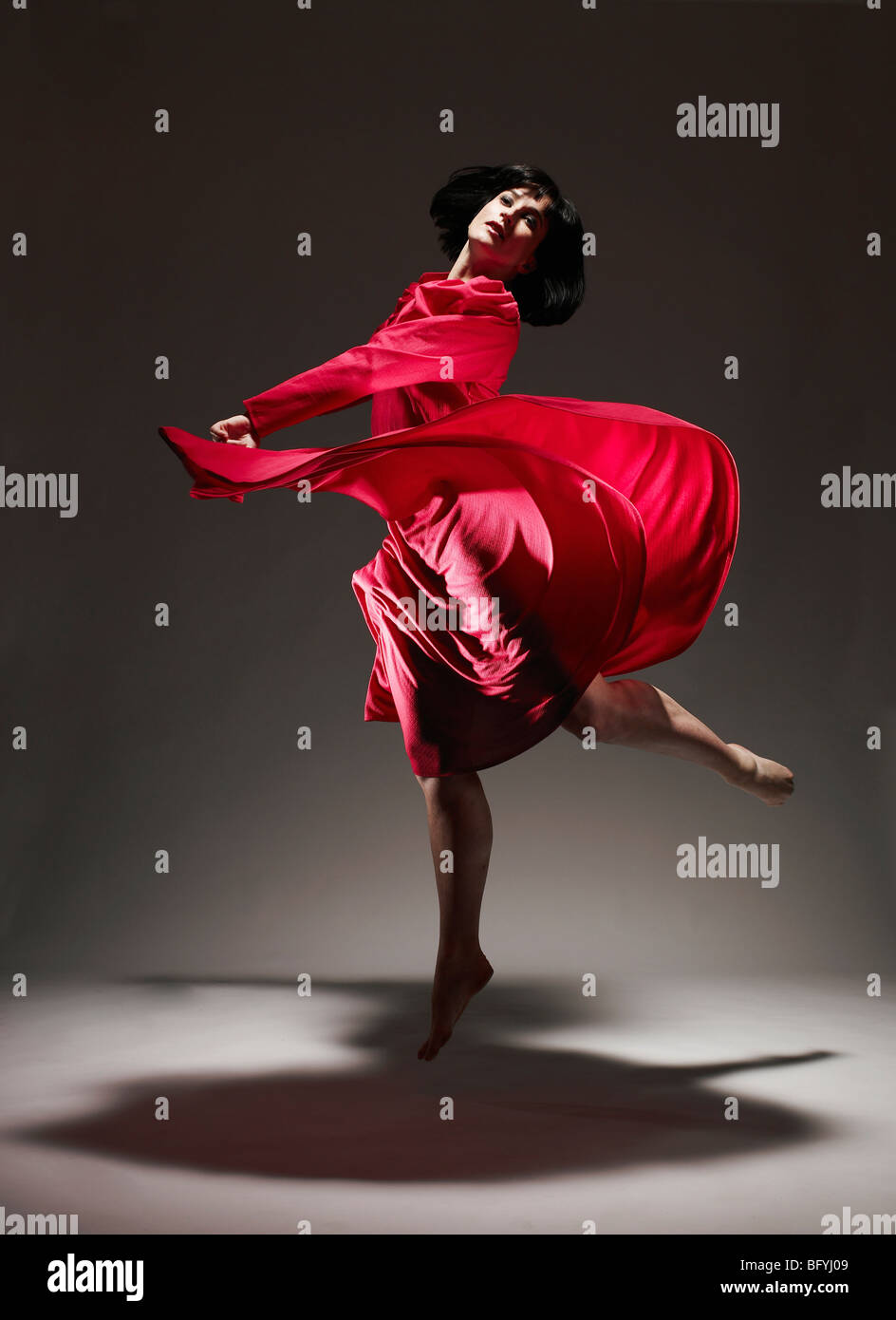 0ce704f7d373 Woman in Red dress dancing under light Stock Photo: 27037033 - Alamy