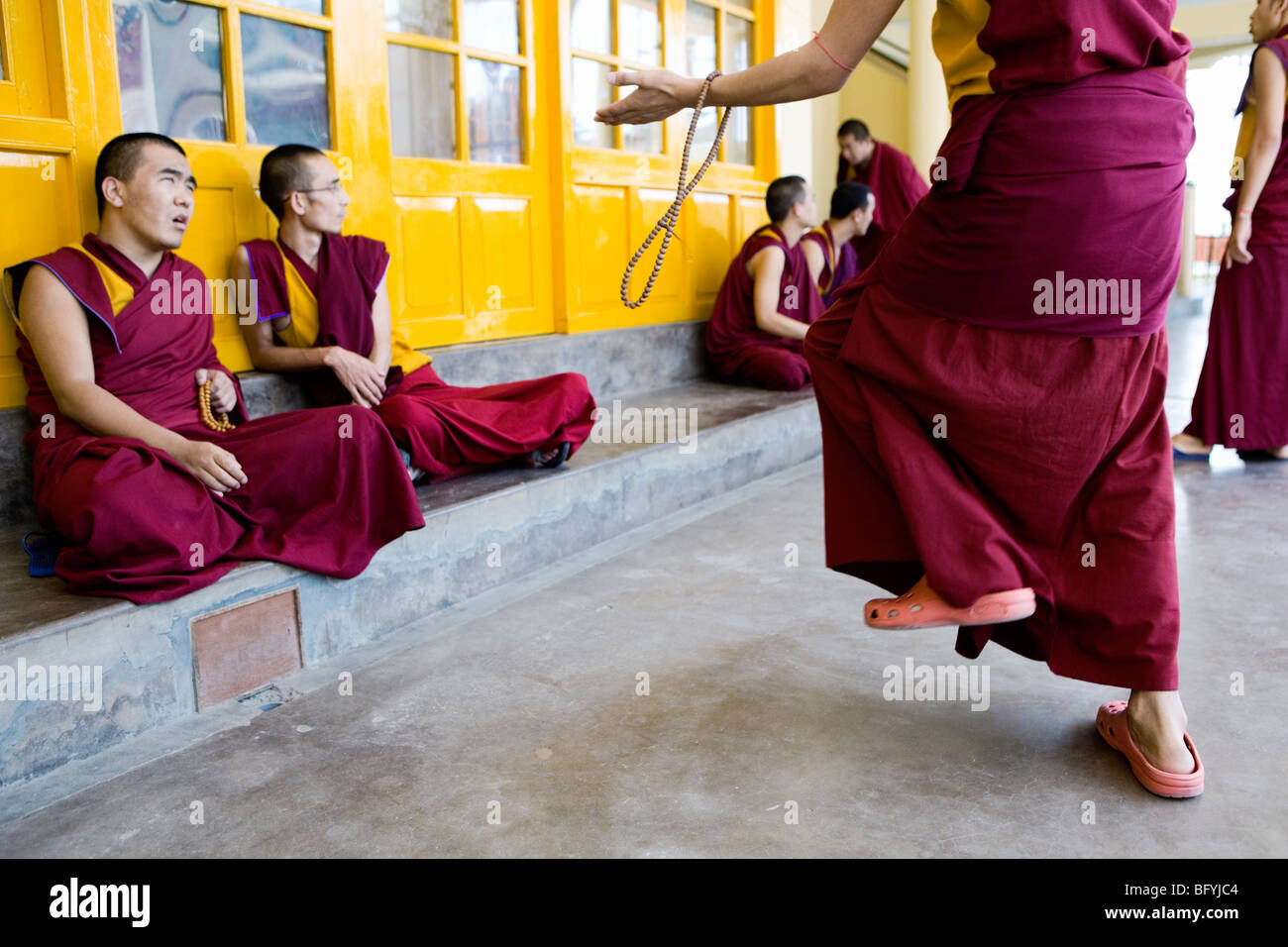 Tibetan Buddhist monks clap their hands loudly while debating about their religion. Namgyal Monastery, Dharamsala, - Stock Image
