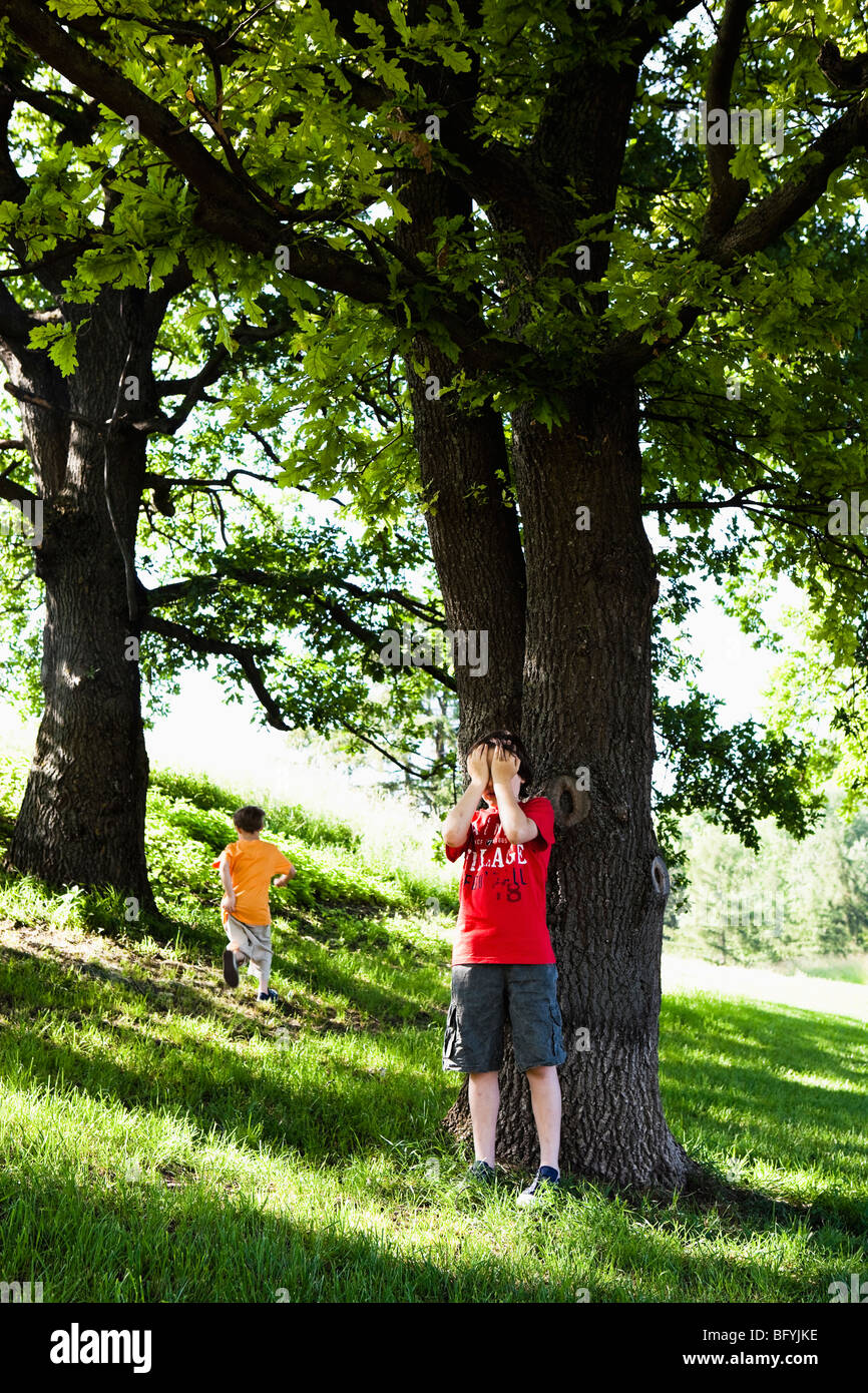 Two Boys Playing Hide and Seek - Stock Image