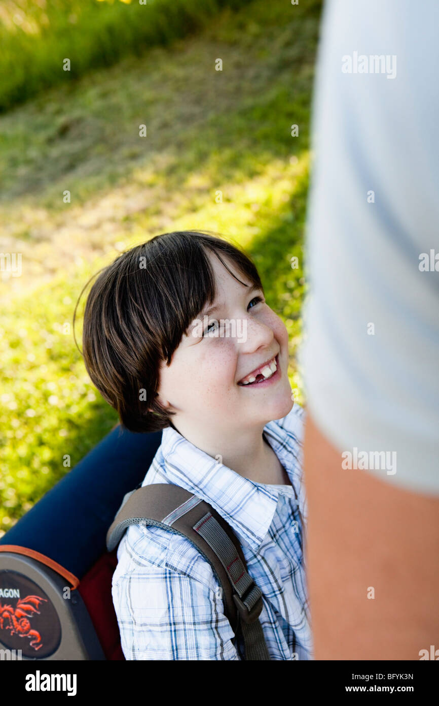Father Walking Son To School Close-Up - Stock Image