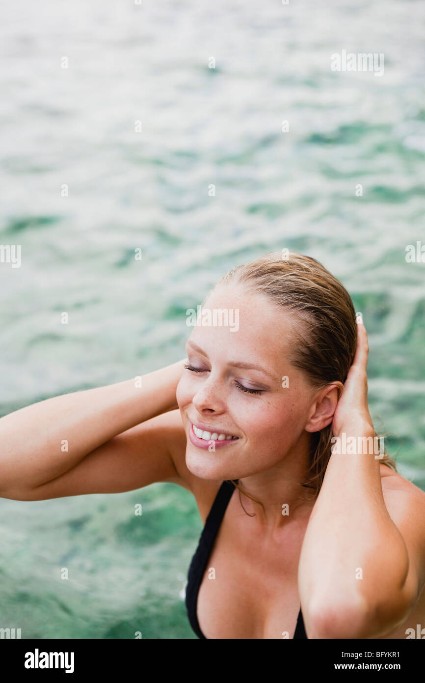 woman coming out of the water - Stock Image