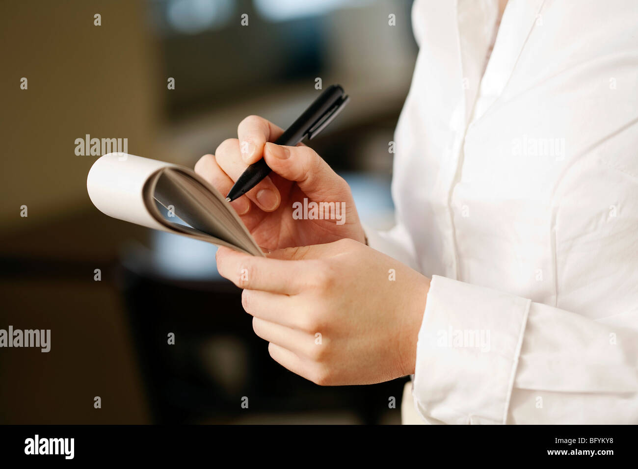close-up of waitress taking an order - Stock Image