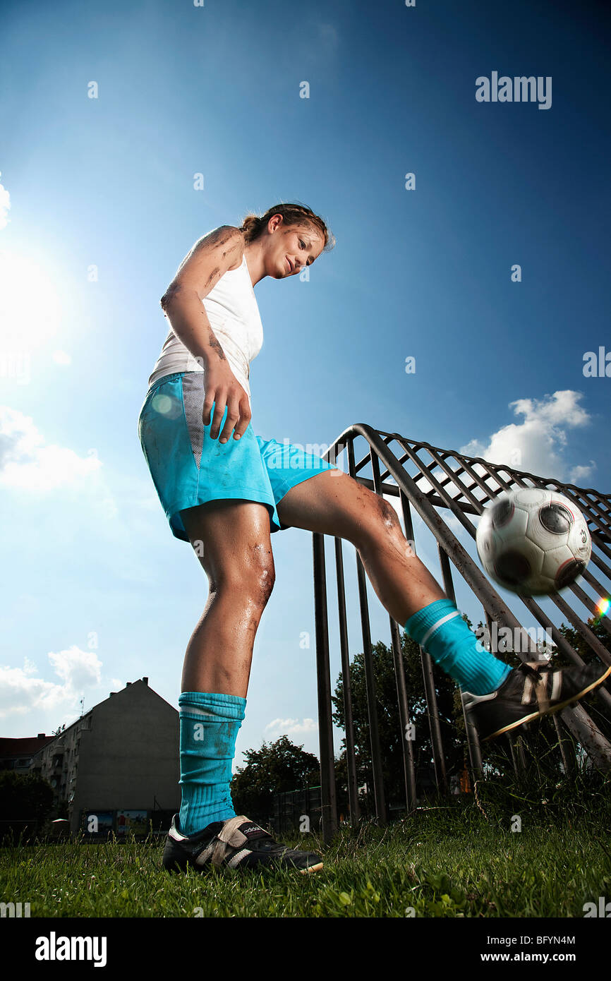 female football player practising with ball - Stock Image