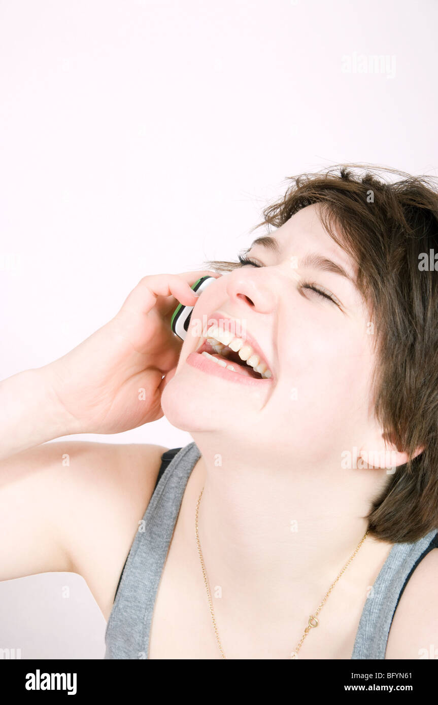 laughing teenage girl talking on mobile phone - Stock Image