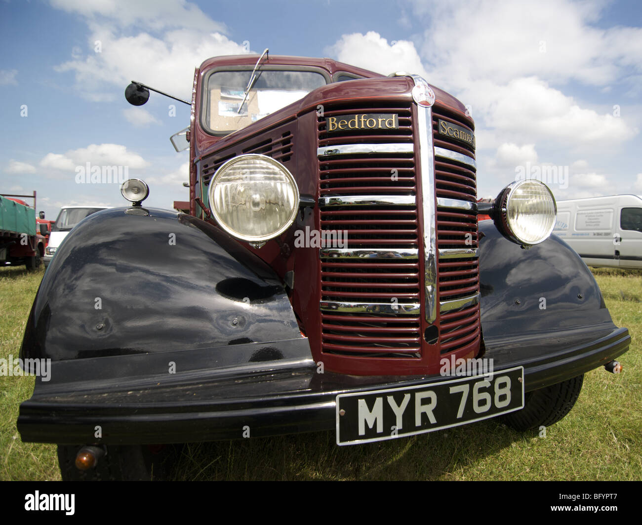 Wide angle shot of an maroon and black 1952 Bedford Scammell seen in 2009 at the Hollowell Steam Rally - Stock Image