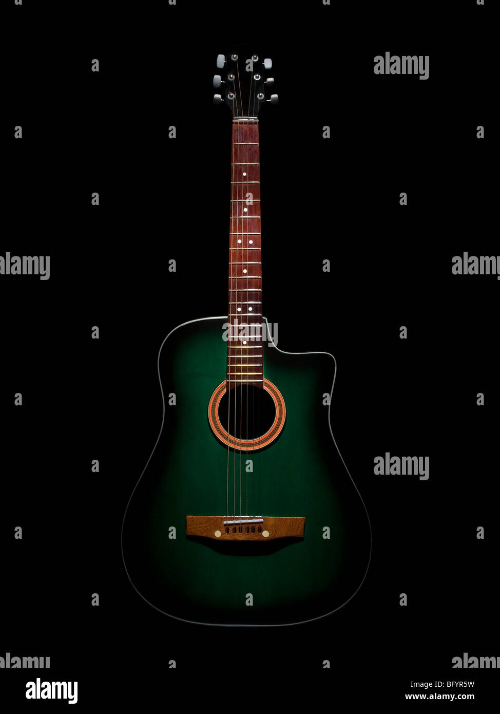 A Green Acoustic Guitar Over Black Background Stock Photo 27041109