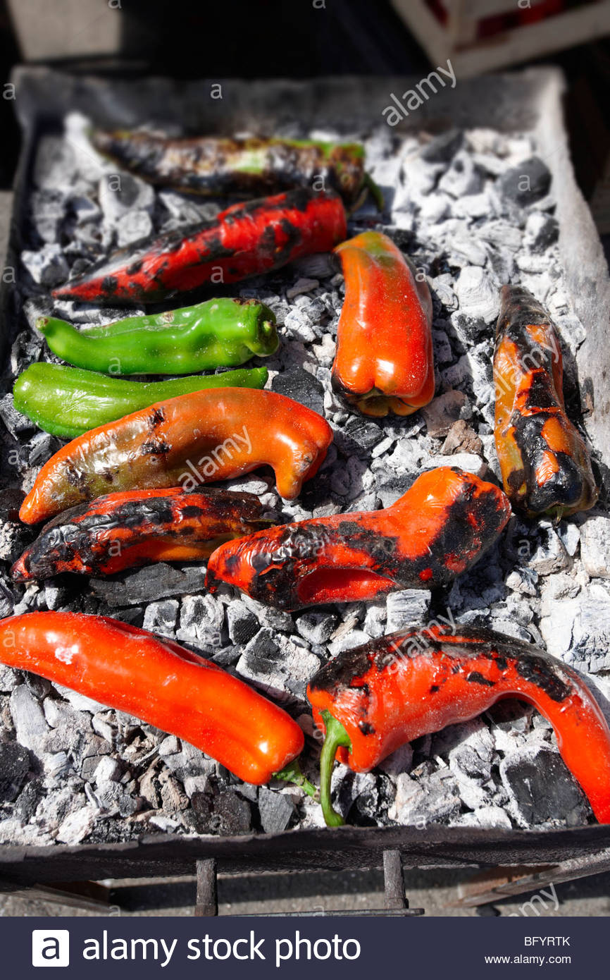 Roasting peppers - Market - Siracusa, Sicily - Stock Image