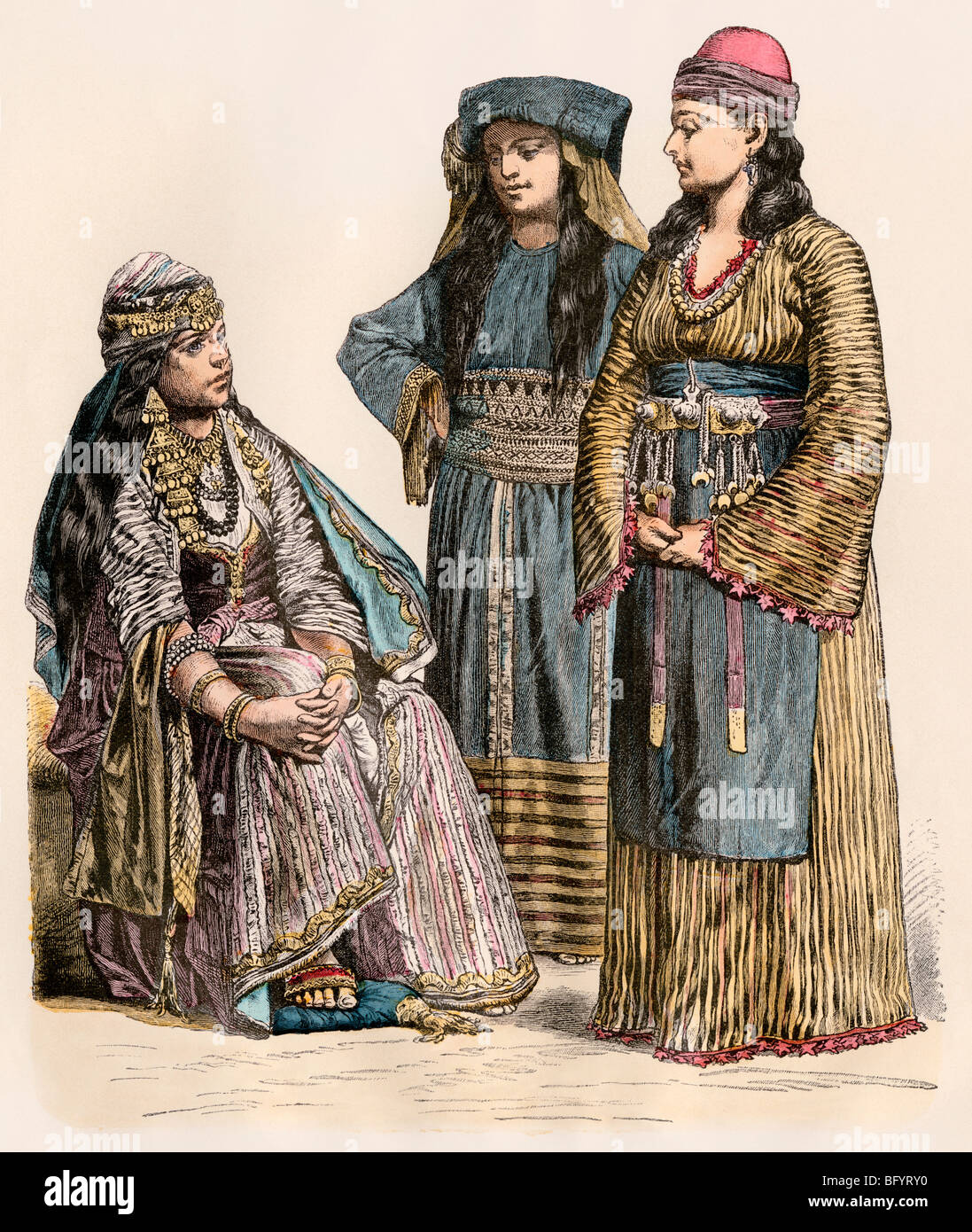 Women of Syria, with a fellah (peasant) woman at right. Hand-colored print - Stock Image