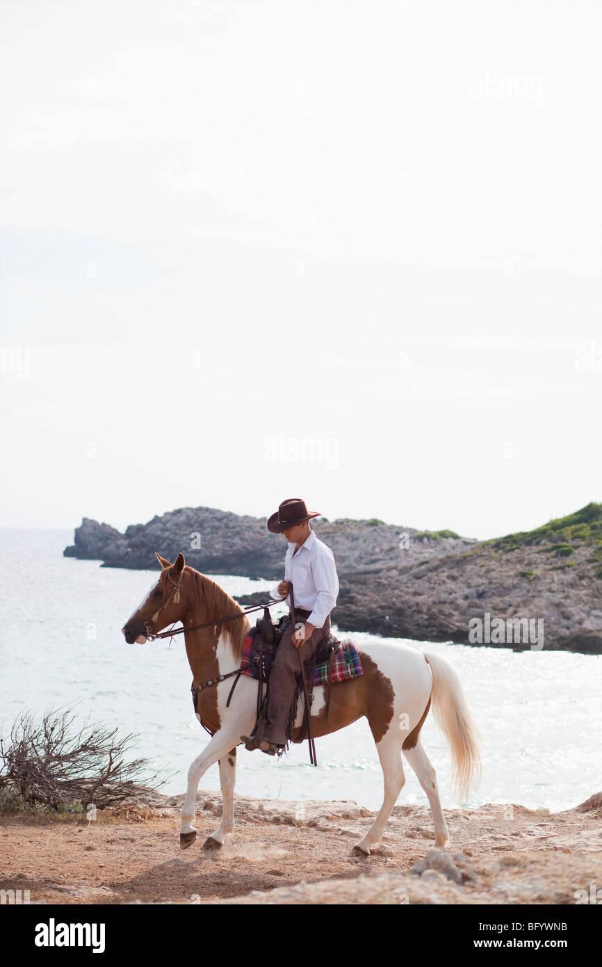 man riding horse - Stock Image