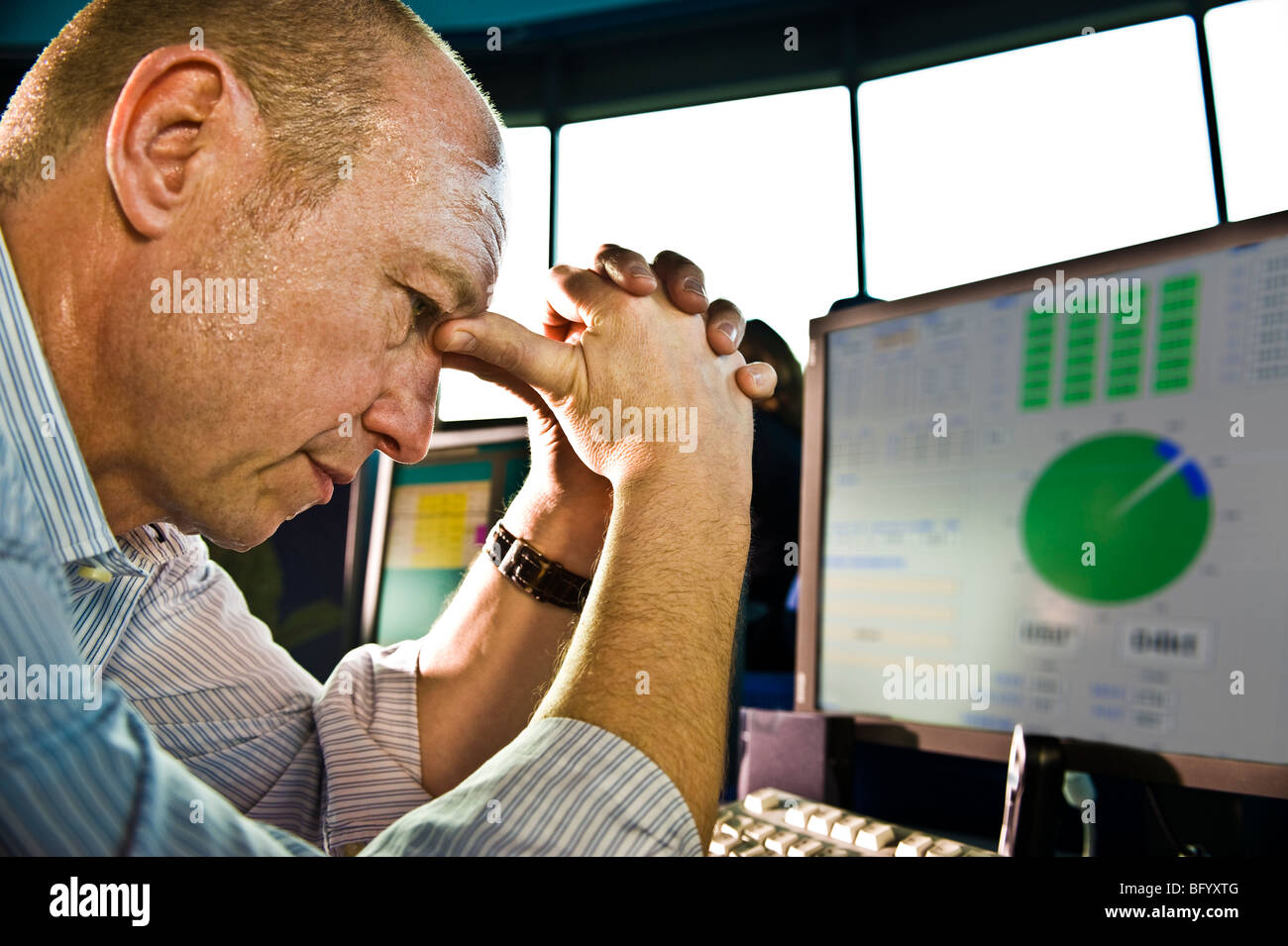 Office operator stress at the computer - Stock Image