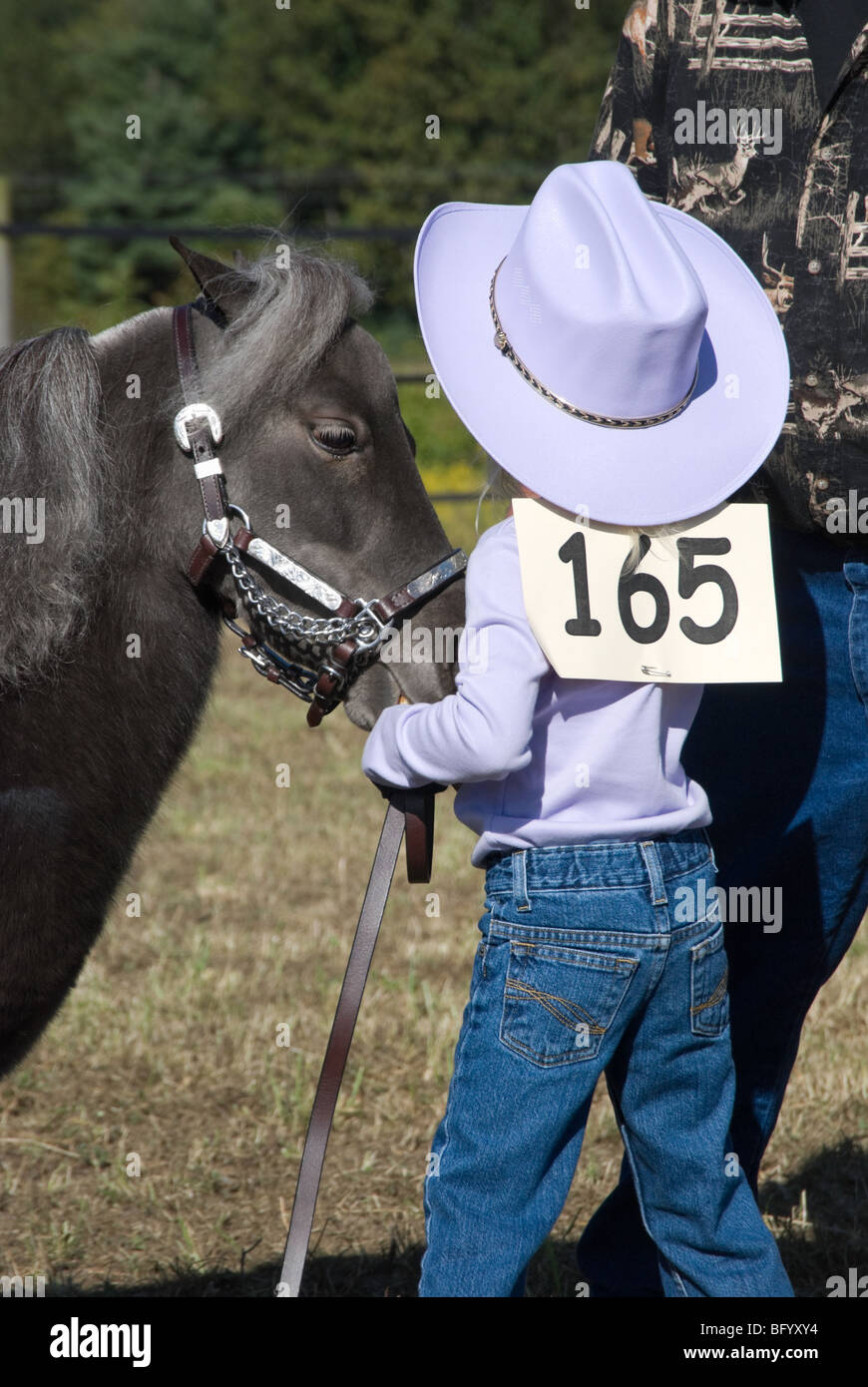 Young girl with lavender top and cowboy hat competing a halter class at a horse  show bf1fea47fe43