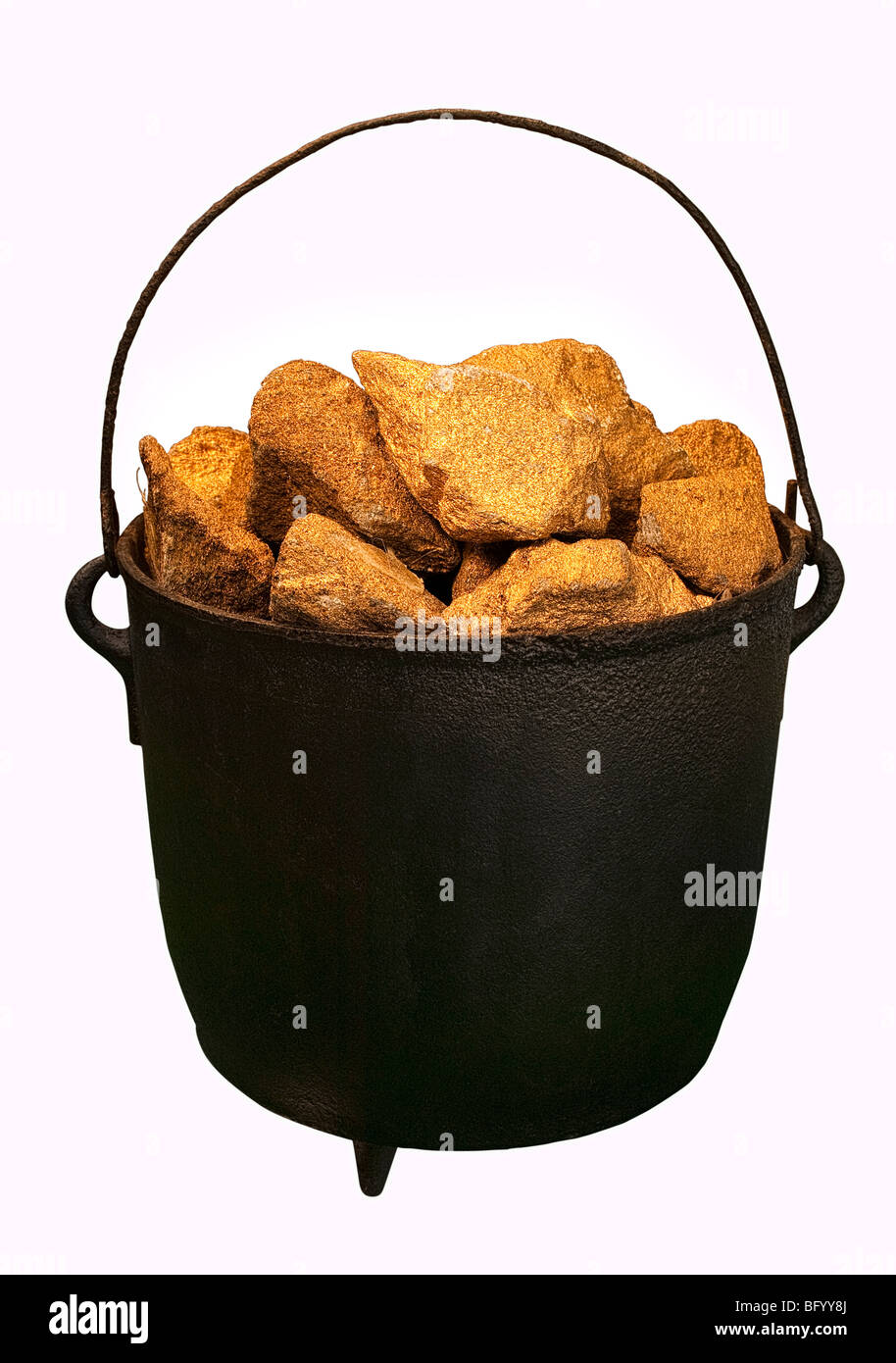 A caldron full of gold nuggets against a white background - Stock Image