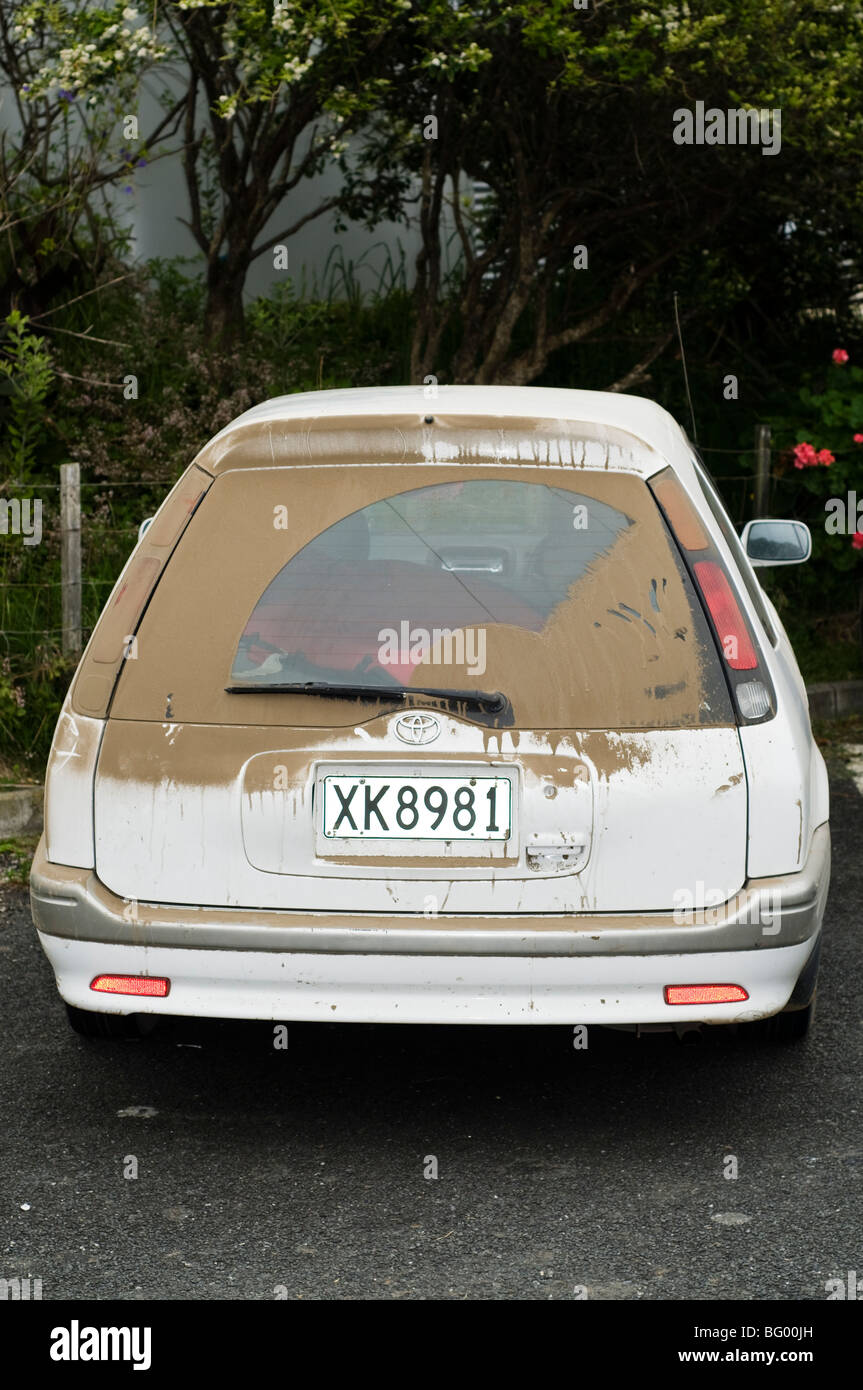 Parked car with dirty rear window - Stock Image