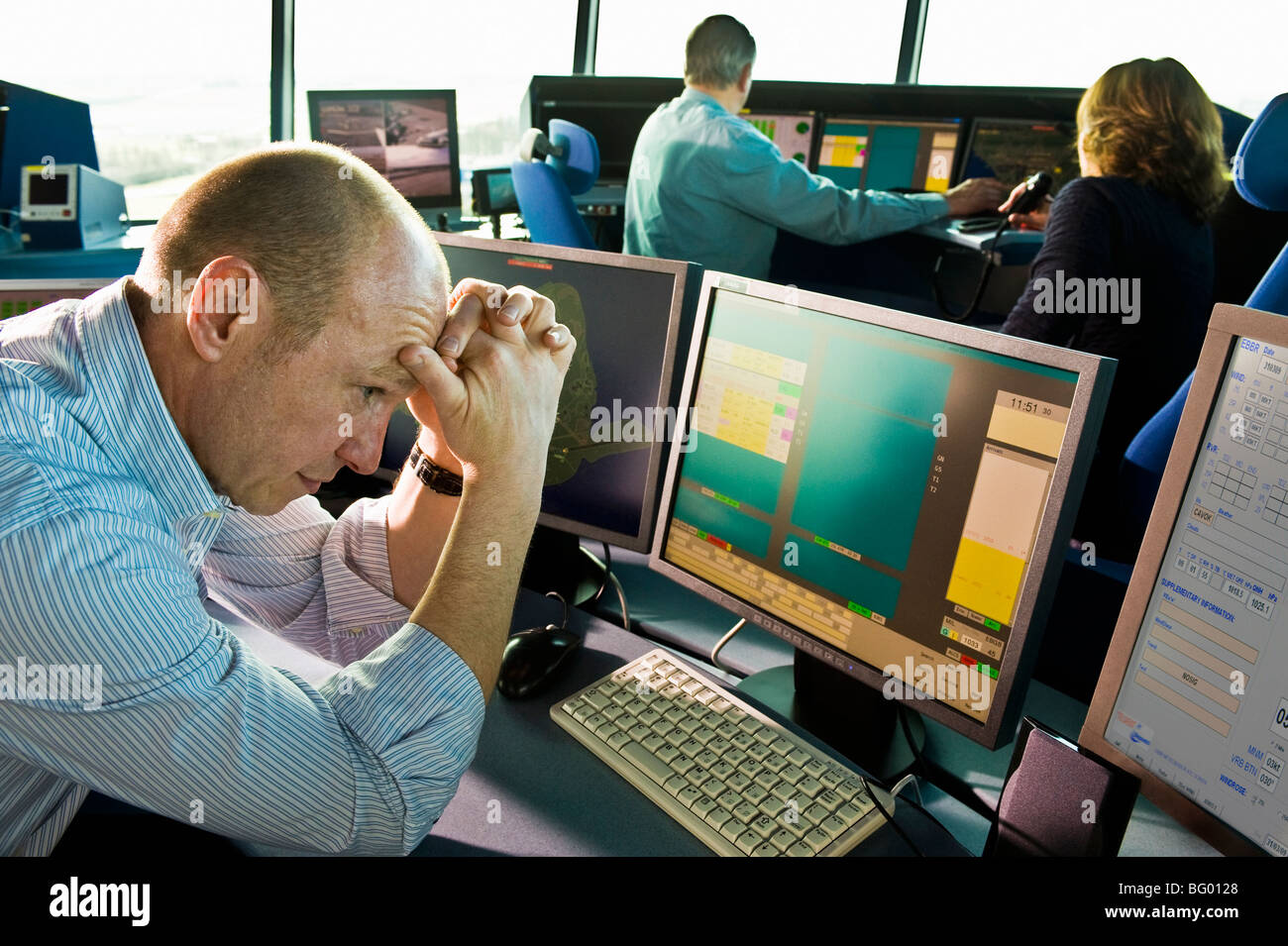 Office operator stress at the computer Stock Photo