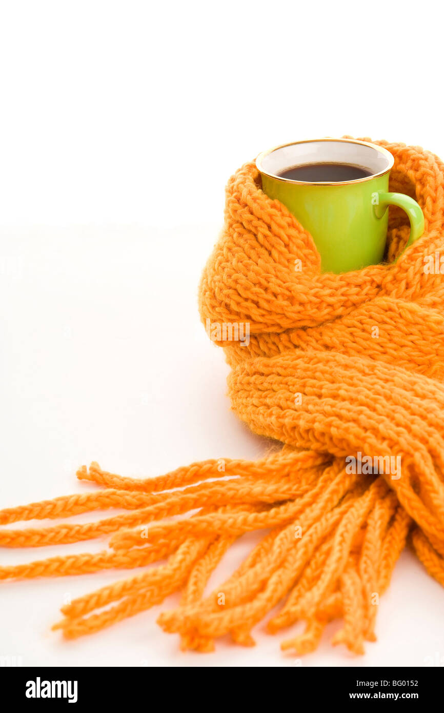 8d80a0ff772ef Green mug wrapped yellow scarf isolated on white background Stock ...