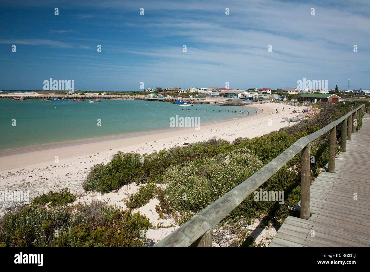 The beach in Struisbaai is the longest continuous white sand beach in South Africa and a boardwalk leads to the - Stock Image