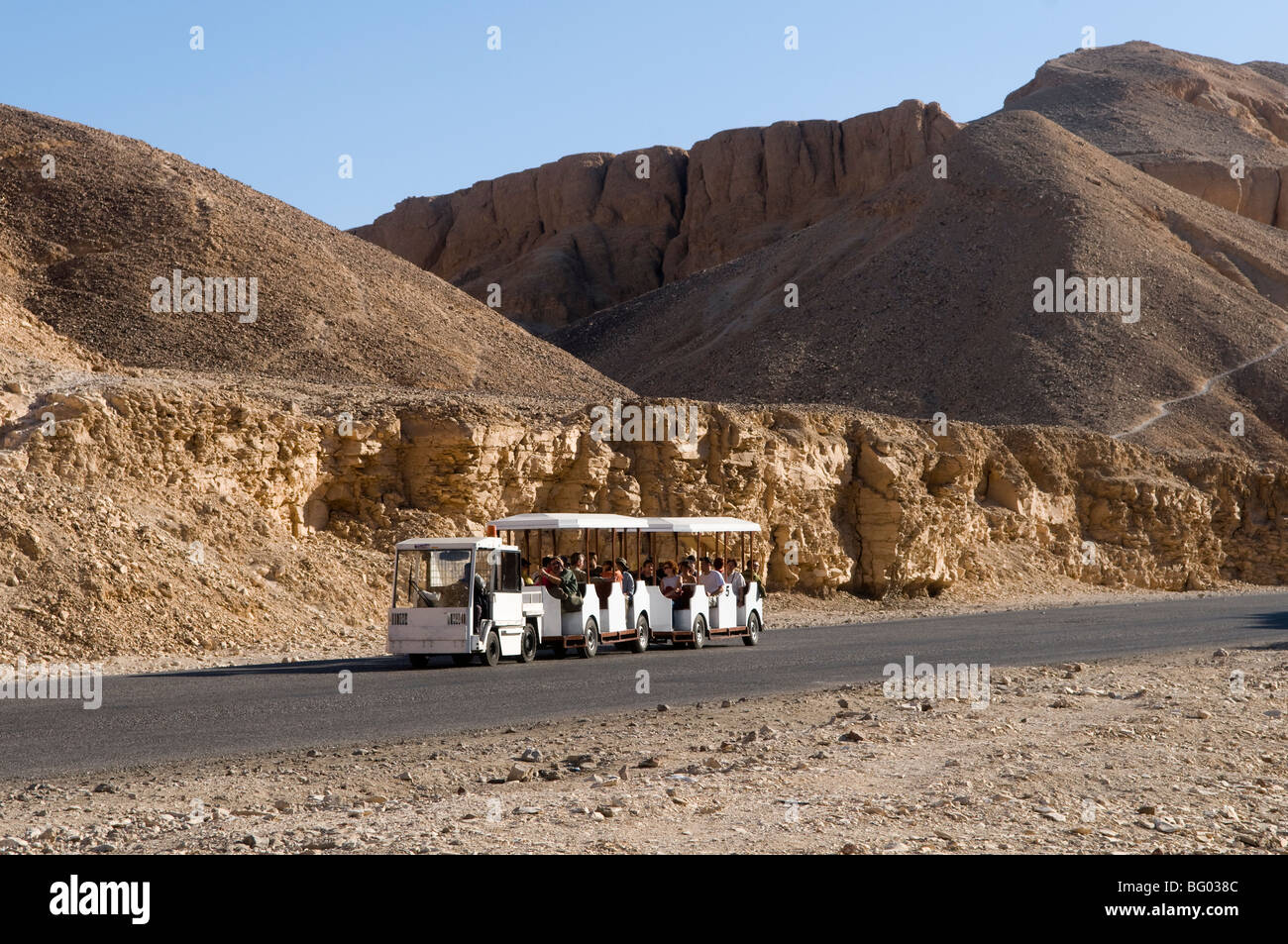 Tourist train at Valley of the Kings near Luxor Egypt - Stock Image