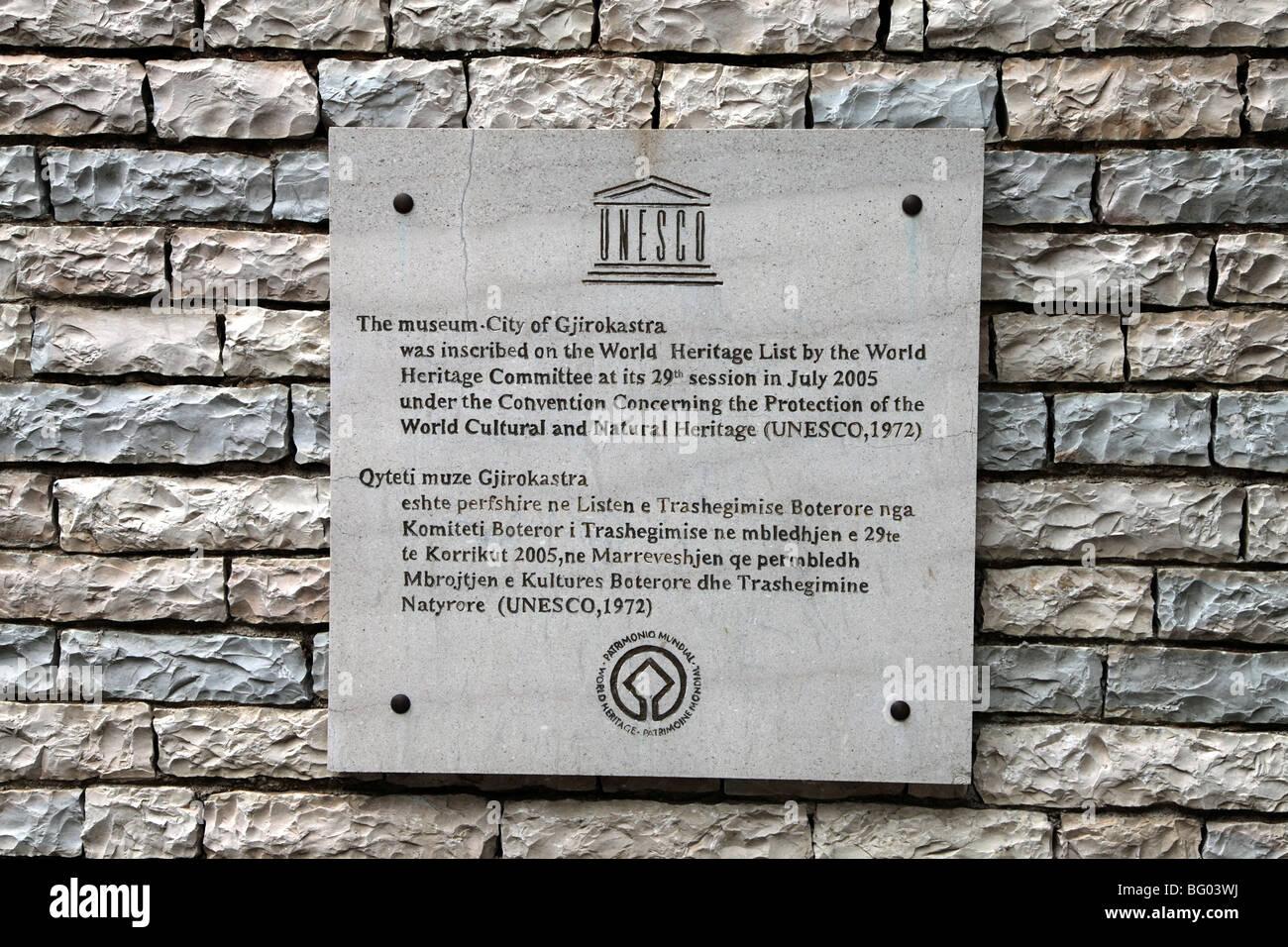 UNESCO World Heritage Site plaque on stone wall in old city of Gjirokastra, Albania - Stock Image