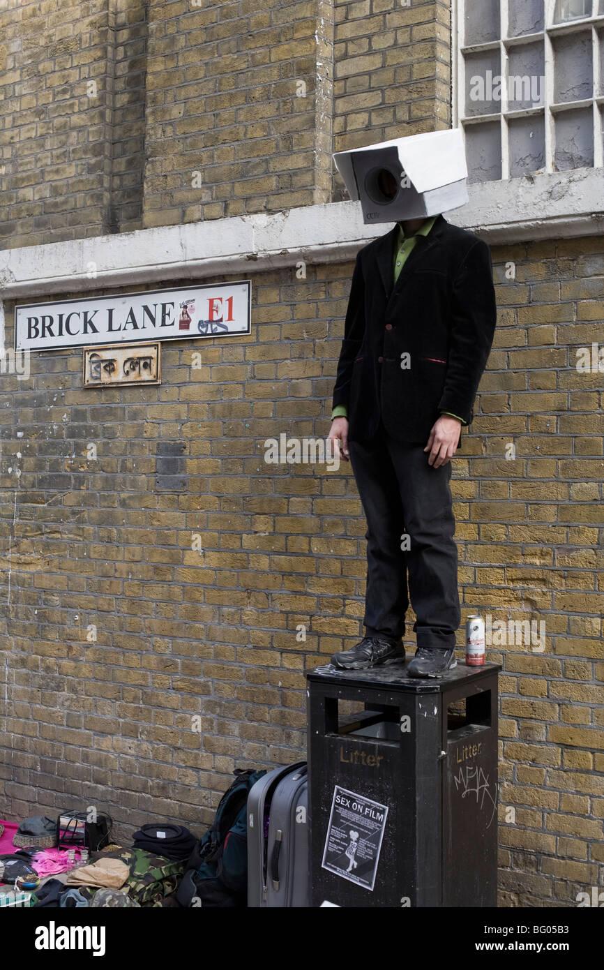 One street performer at East Brick Lane Sunday Flea Market London - Stock Image