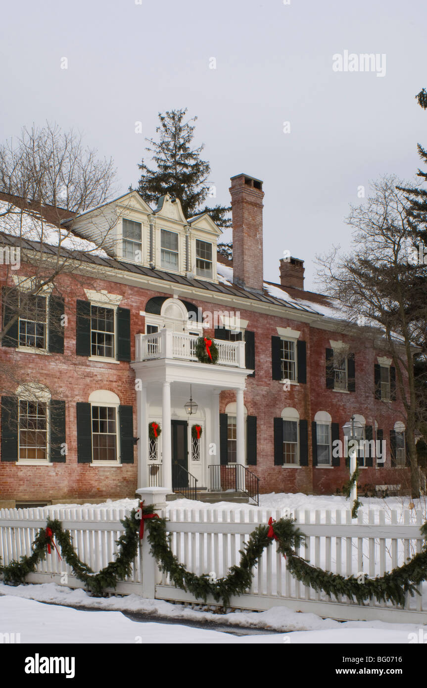 An imposing red brick house decorated for Christmas with wreaths and garlands, Woodstock, Vermont, New England, - Stock Image
