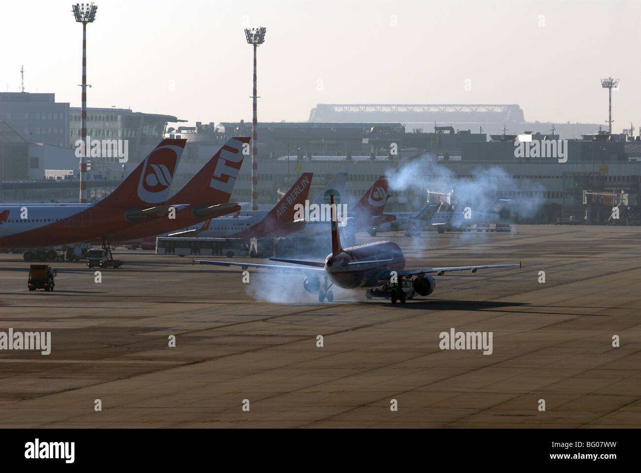 Commercial airliner staring jet engines on a cold winter morning - Stock Image