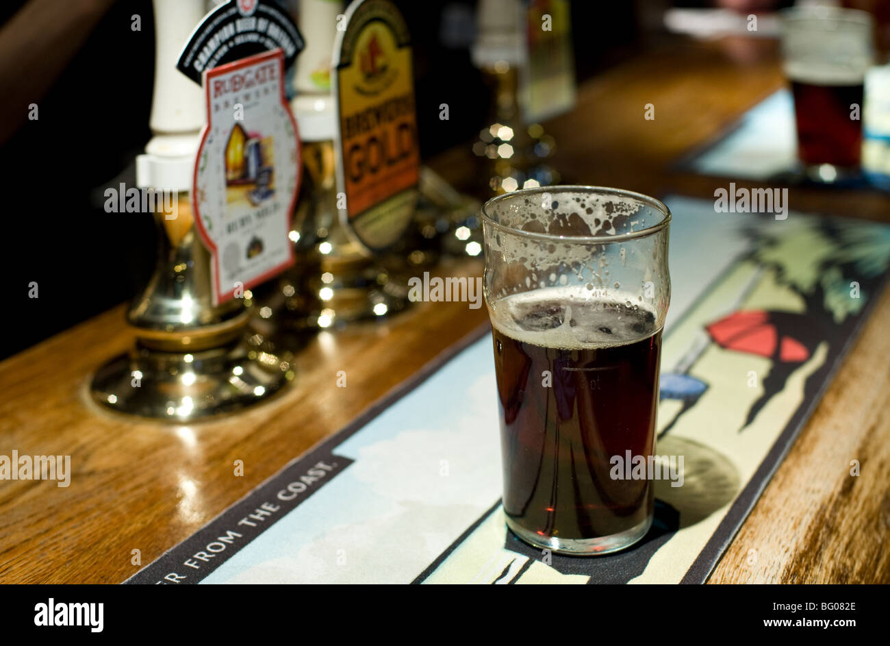 A pint of real ale on the bar of a public house in Essex.  Photo by Gordon Scammell - Stock Image