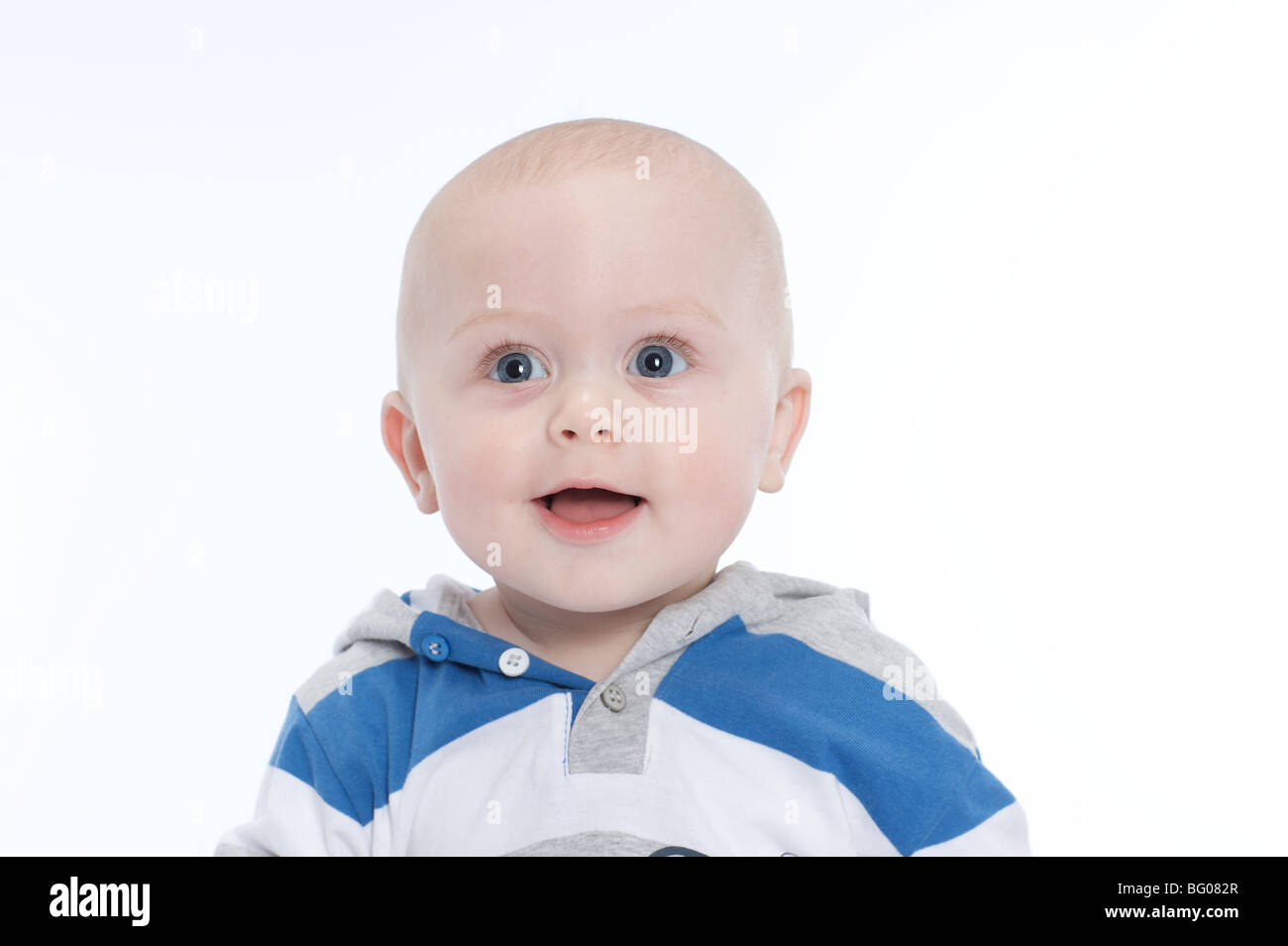 beautiful cute caucasion 6 month old smiling baby boy with hooded