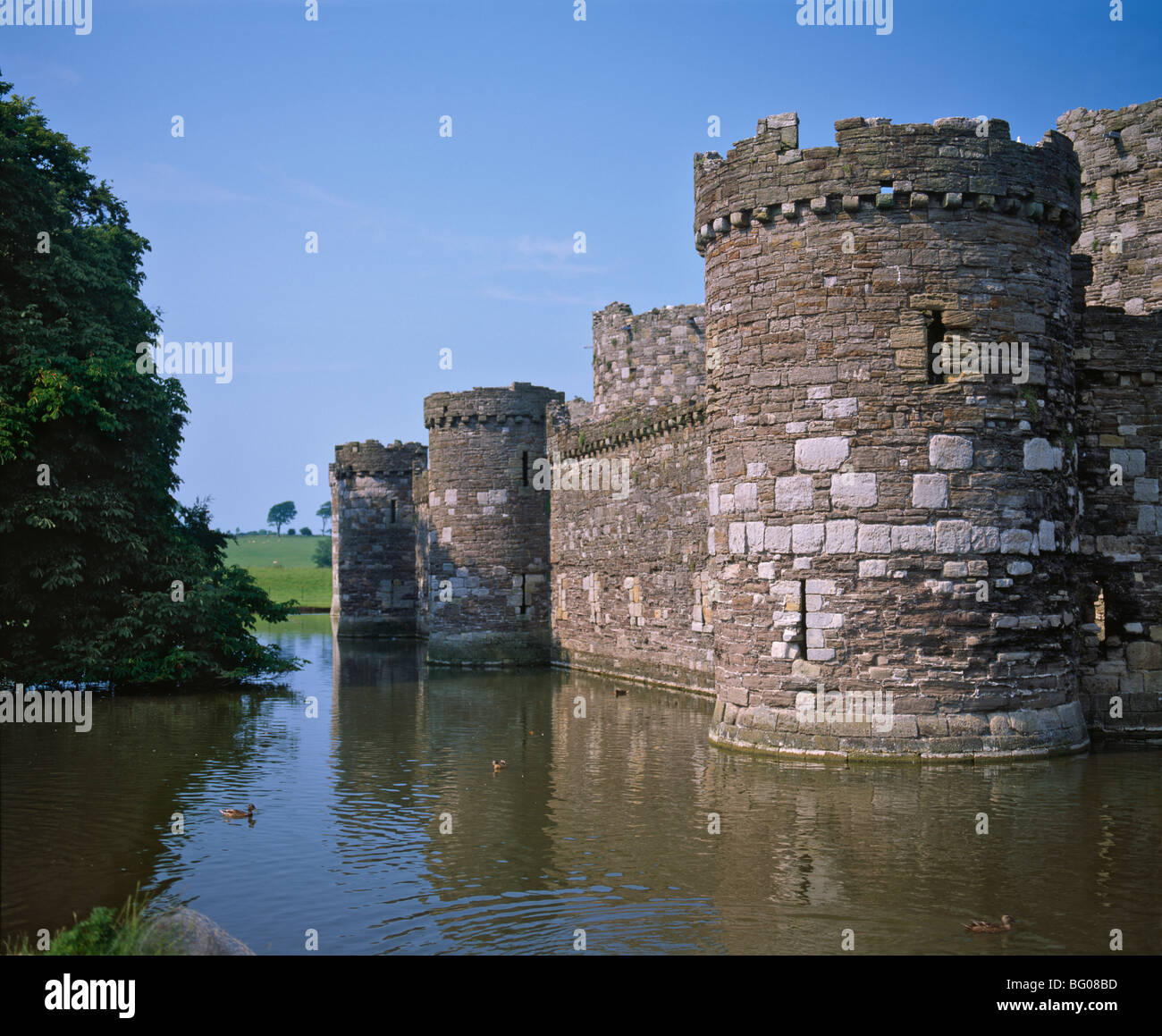 Moat and outer curtain wall at Beaumaris Castle,  built 1295-98 by King Edward I, Anglesey, North Wales, United - Stock Image