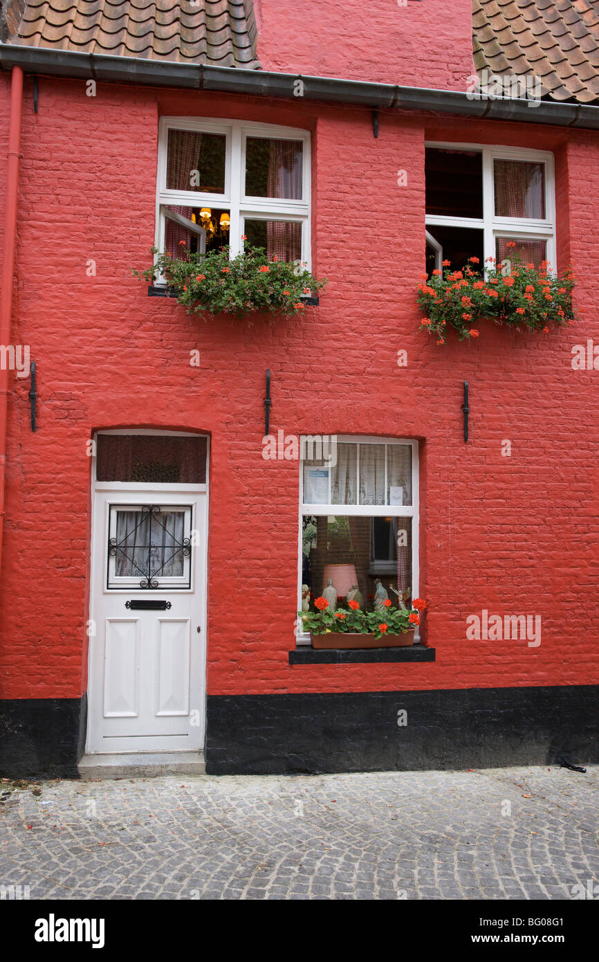 Pretty Red Painted Brick House With Window Boxes Full Of Flowers In