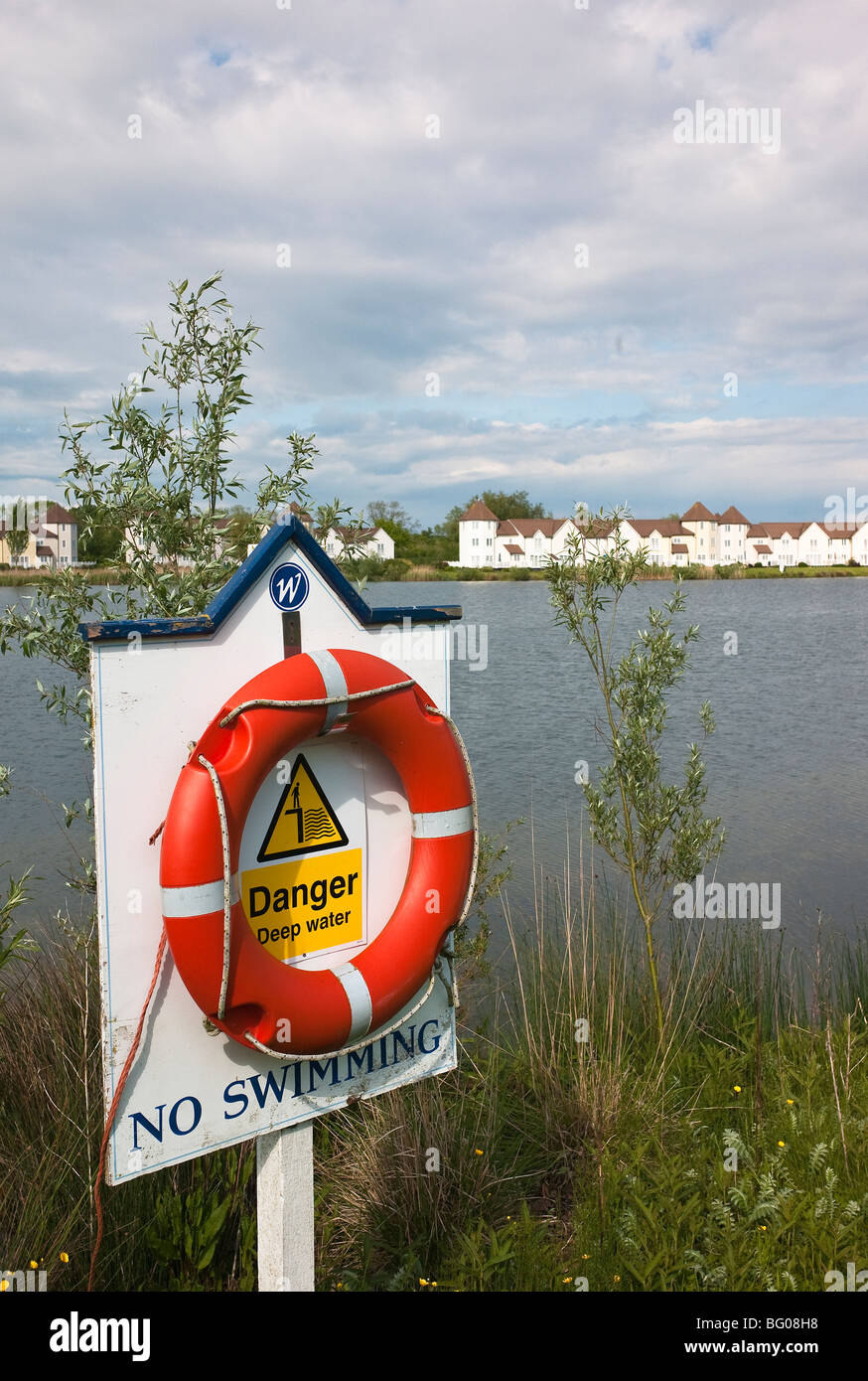 Health and safety warning notice beside water where swimming is not permitted - Stock Image
