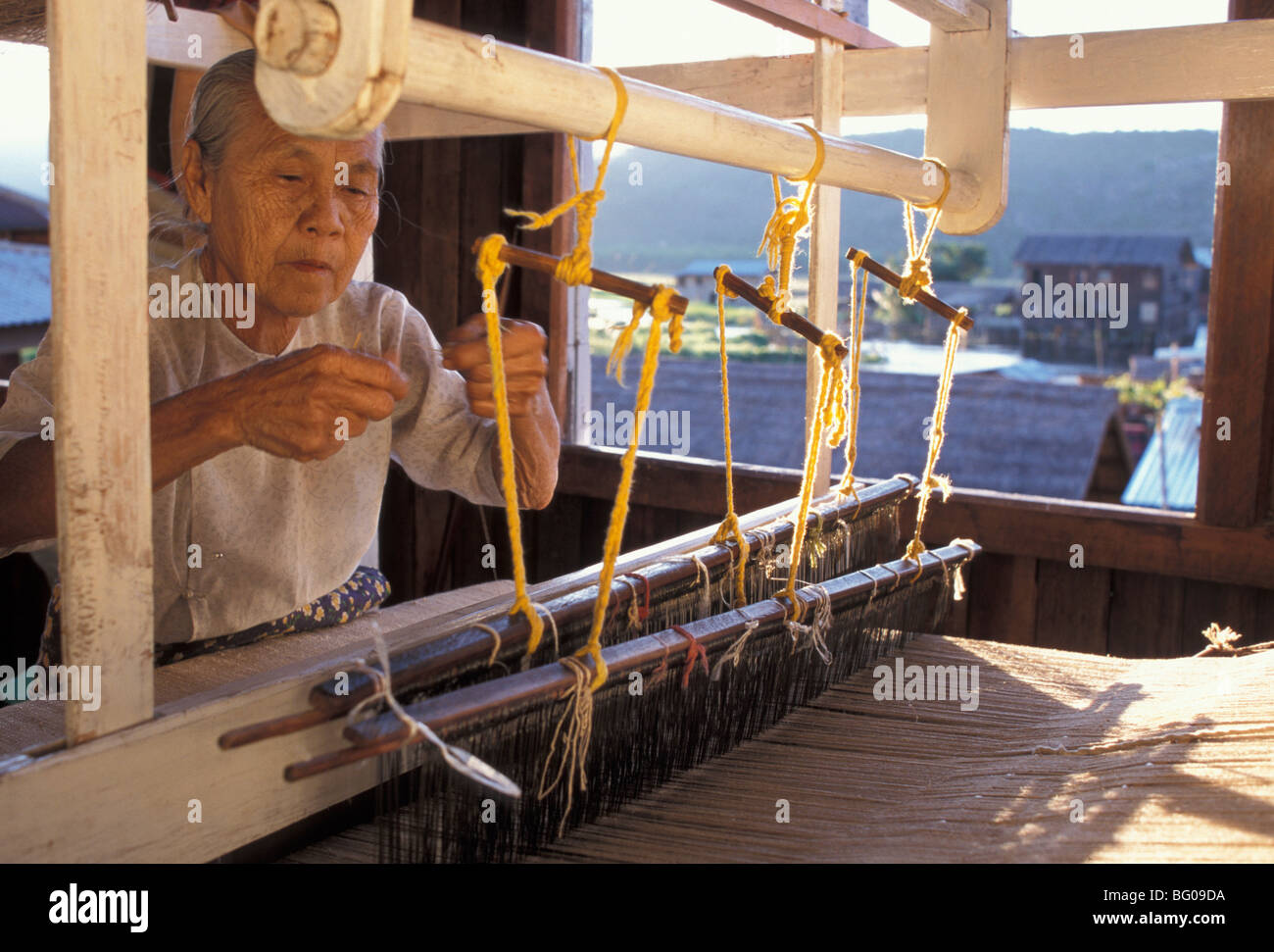 Weaver with her loom, Inle Lake, Shan State, Myanmar (Burma), Asia - Stock Image