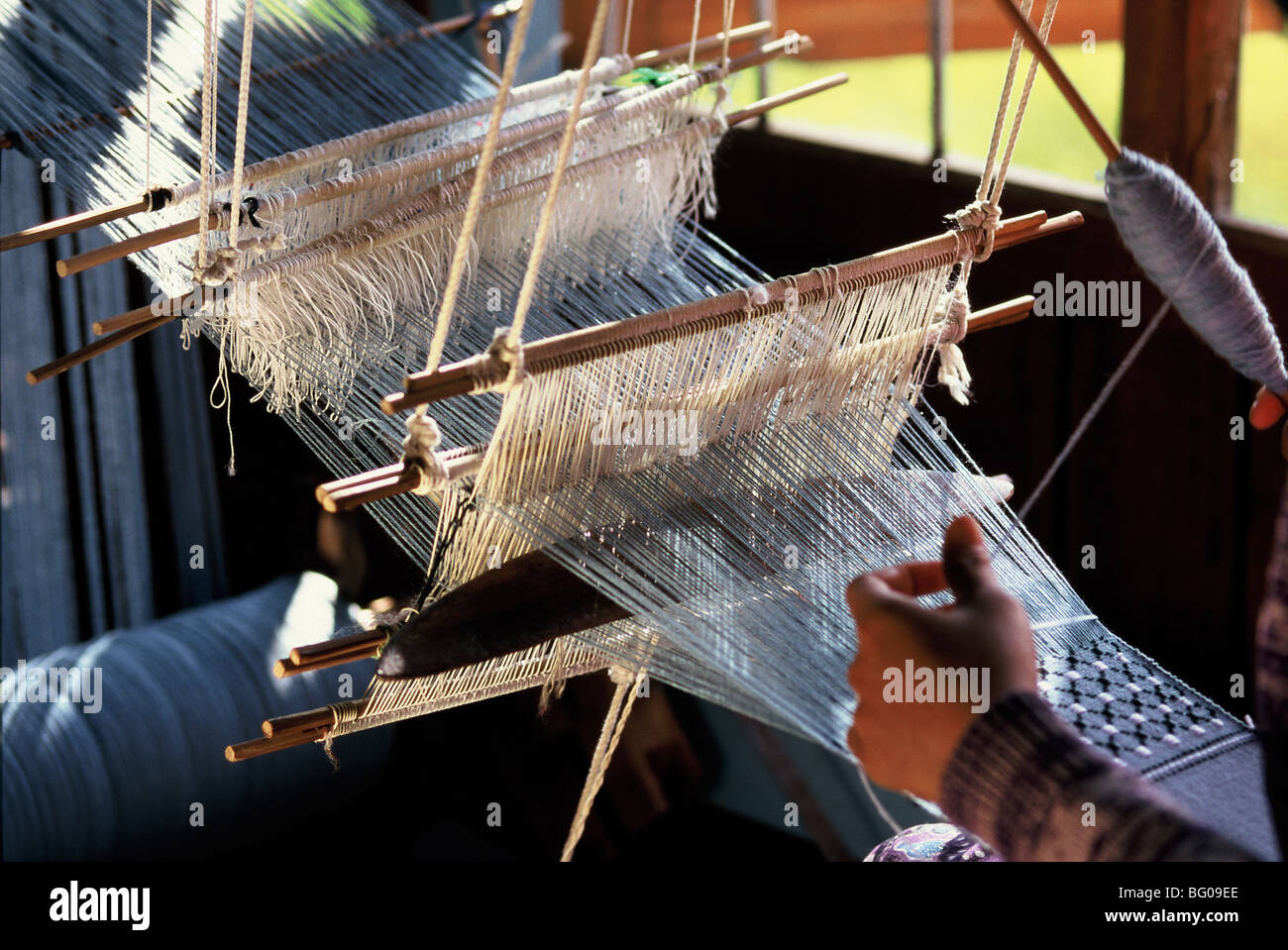 Weaving cotton fabrics on a traditional multiple-harness frame loom, Inle Lake, Shan State, Myanmar (Burma), Asia - Stock Image