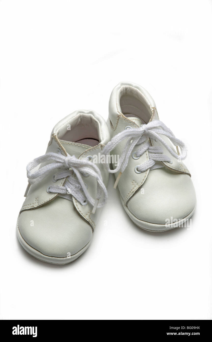 White baby shoes on white - Stock Image
