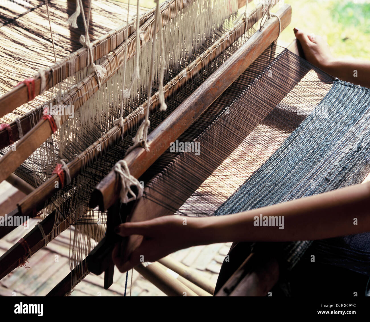 Weaving cotton in Chiang Mai, Thailand, Southeast Asia, Asia - Stock Image