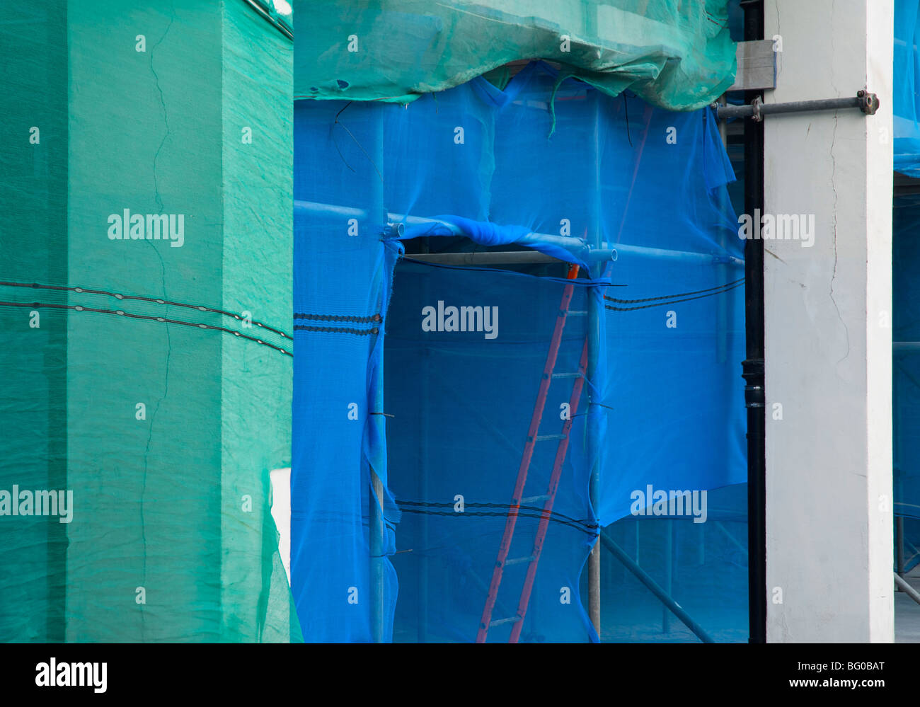 Scaffolding on building being renovated - Stock Image