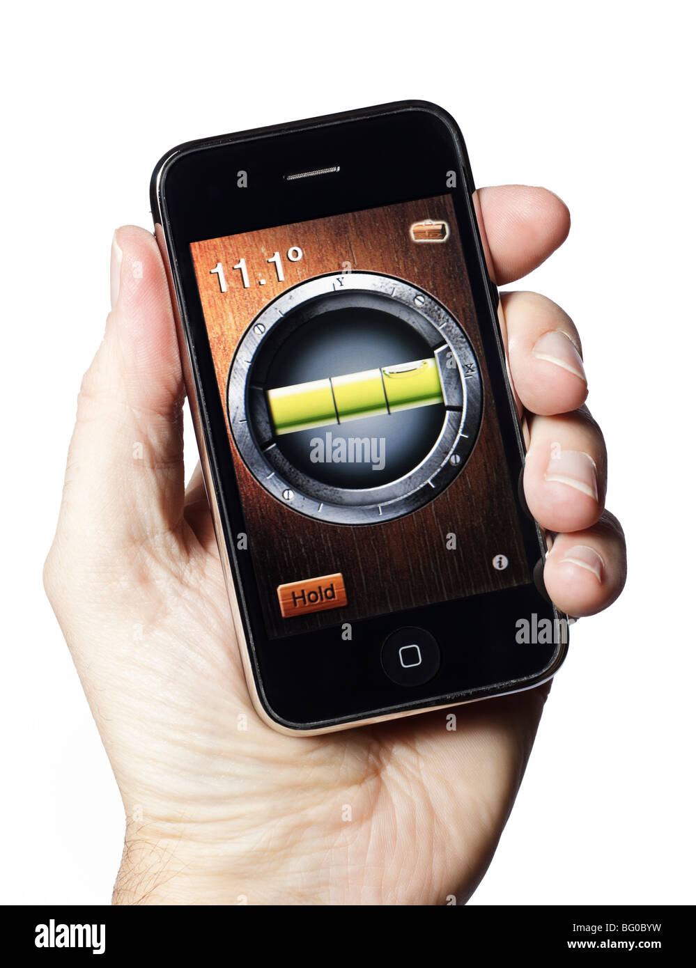 Male hand holding iPhone using a spirit level application - Stock Image