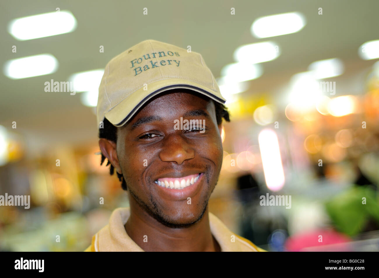 african man working in bakery, tambo international airport, johannesburg Stock Photo