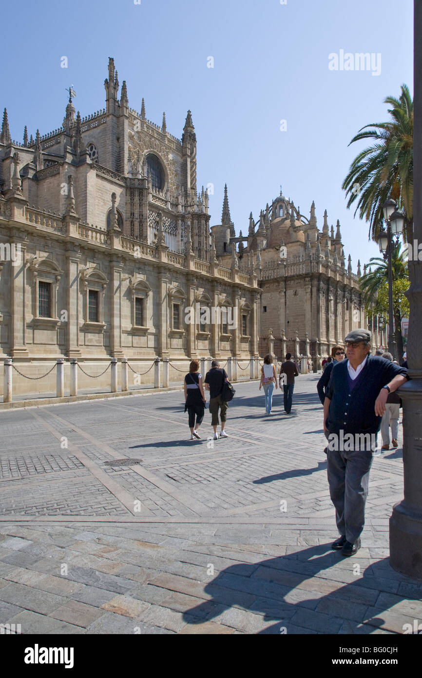 Tourists in front of a cathedral, Seville Cathedral, Seville, Spain, Patrimonio de la Humanidad - Stock Image